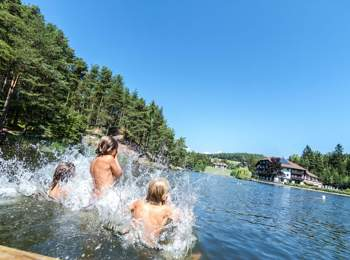 Bathing fun at Lake Wolfsgruben on Ritten